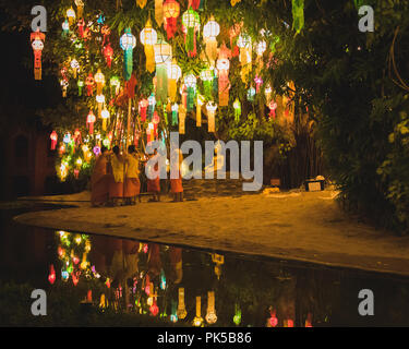 Monks setting up for Loy Krathong in Chiang Mai Thailand - Stock Photo