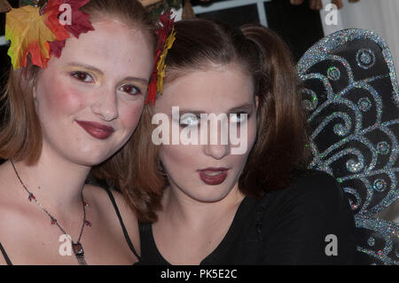 Two teen girls in makeup and costume - Stock Photo