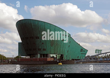 NEMO Science Museum (from latin Nobody) is a science center in Amsterdam, Netherlands seen her from the water. The architect was Renzo Paiano - Stock Photo