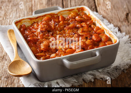 Vegetarian Balkan food prebranac baked beans with onions close-up in baking dish on a table. horizontal - Stock Photo