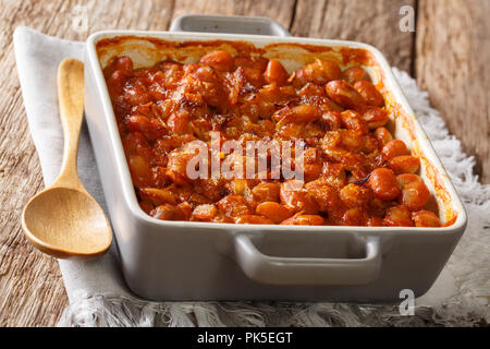 Traditional Balkan recipe prebranac baked beans with onion close up in baking dish on the table. horizontal - Stock Photo