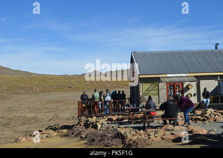 People eating and drinking in the Pass By Cafe or bar on