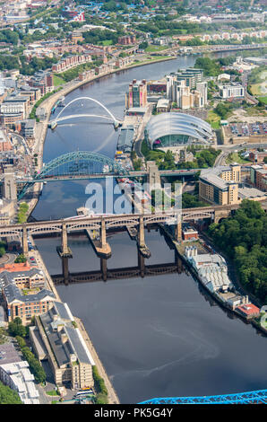 Ariel photograph taken from light aircraft of the River Tyne, the High Level, Tyne, Swing and Millenium Bridges between Gateshead and Newcastle. - Stock Photo
