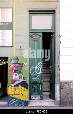 Old building facade with a tango graffiti on it in Buenos Aires, Argentina - Stock Photo