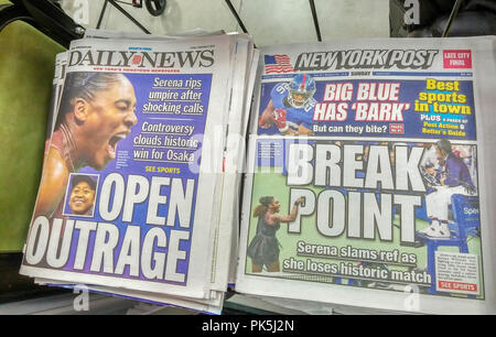 The New York Post and the New York Daily News  newspapers on Sunday, September 9, 2018 report on the previous days controversial loss by Serena Williams to Naomi Osaka the the U.S. Open tennis tournament. Williams received three violations for receiving visual instructions from her coach during a game, smashing her racket and finally a verbal attack on the referee.  (© Richard B. Levine) - Stock Photo