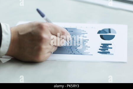 close up. businessman checking financial data. business concept - Stock Photo