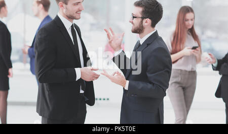 close up.business colleagues discuss business problems standing in the office - Stock Photo