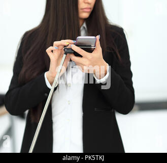 young employee of the company preparing to take a selfie. - Stock Photo