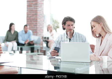 Manager is talking to in the Bank office - Stock Photo