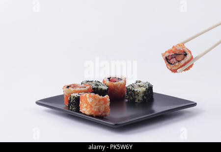 Sushi and rolls. the set is served on a black plate - Stock Photo