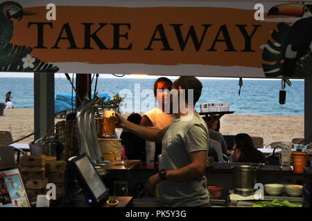 Scene on take away beach bar in Marbella beach, Poblenou, Barcelona, Spain - Stock Photo
