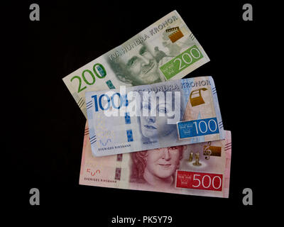 Swedish currency bank notes depicting famous Swedes on black background, 500, 200, 100 kronor