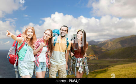group of friends with backpacks on big sur coast - Stock Photo