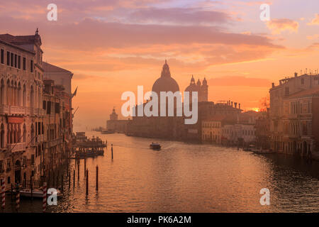 Venice in the early morning. Boat on the water. Picture taken from the Academy bridge. Italy. - Stock Photo