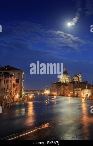 The moon shines over Venice. Picture taken from the Academy bridge. Italy. - Stock Photo