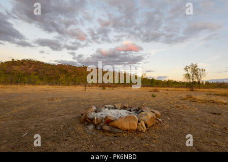 Campfire ring at Sunrise in the Outback at Chillagoe, Northern Queensland, QLD, Australia - Stock Photo