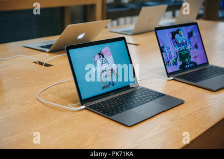 Berlin, August 29, 2018: Retail sale of new MacBooks in the official store of Apple in Berlin. Modern and stylish laptops. - Stock Photo