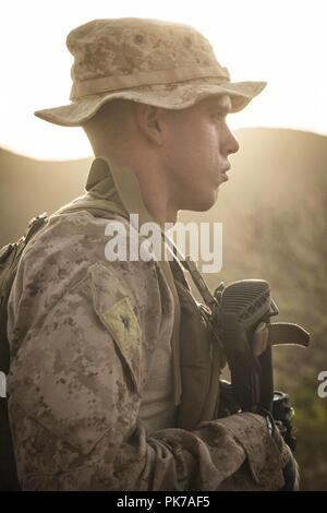 Djibouti. 10th Sep, 2018. DJIBOUTI (Sept. 8, 2018) Lance Cpl. Riley Crider, a machine gunner assigned to Kilo Company, Battalion Landing Team 3/1, 13th Marine Expeditionary Unit, waits for orders during a fire team maneuver drill while participating in Theater Amphibious Combat Rehearsal (TACR) 18. Led by Naval Amphibious Force, Task Force 51/5th Marine Expeditionary Brigade, TACR integrates U.S. Navy and Marine Corps assets to practice and rehearse a range of critical combat-related capabilities available to U.S. Central Command, both afloat and ashore, to promote stability and security - Stock Photo