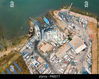 Aerial view of dry docks and shipyard with many boats in Olhao, Portugal - Stock Photo