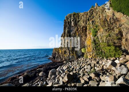Sheer cliffs of the northern coast of Bornholm island - Jons Kapel (John's Chapel), Denmark - Stock Photo