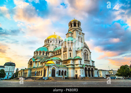 St. Alexander Nevsky Cathedral in the center of Sofia, capital of Bulgaria against the blue morning sky with colorful clouds - Stock Photo