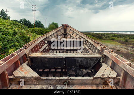 An old abandoned fishing boat - Stock Photo