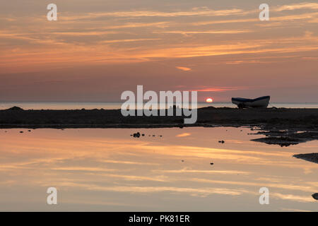 Dawn breaking over Sandsend beach near Whitby on the North Yorkshire coast, England. - Stock Photo