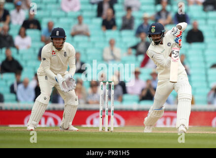 India's KL Rahul (right) hits out for a boundary during the test match at The Kia Oval, London. - Stock Photo