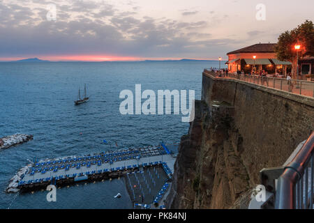 The restaurant in the evening on a cliff overlooking the bay. Sant Agnello. Italy. - Stock Photo