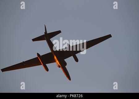 A U2 flies over Northern California at sunset. - Stock Photo
