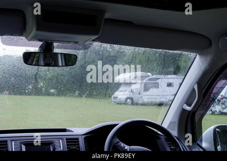 Campervan on a campsite in the rain - Stock Photo