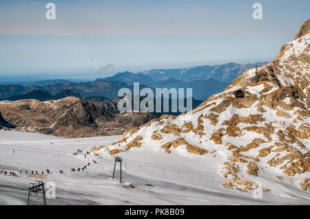 Aerial view of slopes of Dachstein plateau ski resort with glacier and mountains in austrian alps. - Stock Photo