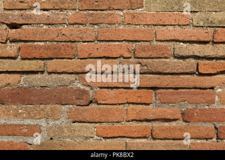 Old brick wall in the archaeological site of Pompeii (Pompei) near Naples, Campania, Italy. - Stock Photo
