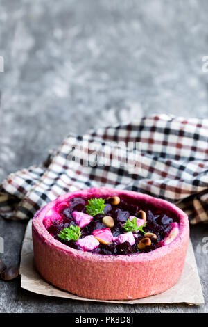 Homemade  balsamic beetroot and goat's cheese quiche on wooden table - Stock Photo