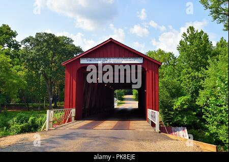 Princeton, Illinois, USA. The Red Covered Bridge spans Big Bureau Creek. The 149-foot bridge was built in 1863 and it remains open to traffic. - Stock Photo
