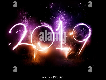 Happy New Year! 2019 displayed with fireworks and strobes. Celebrations concept. - Stock Photo