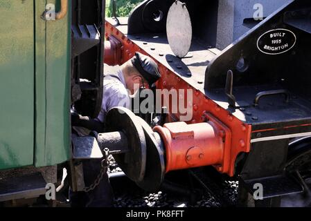 Corfe, England - June 03 2018: Train driver uncoupling the engine from the train at Corfe Castle station, on the Swanage Railway in Dorset - Stock Photo