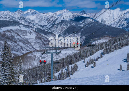 Wildwood Epress Lift 3 with the Gore Range in the background, Hunky Dory ski trail, winter, Vail Ski Resort, Vail, Colorado. - Stock Photo