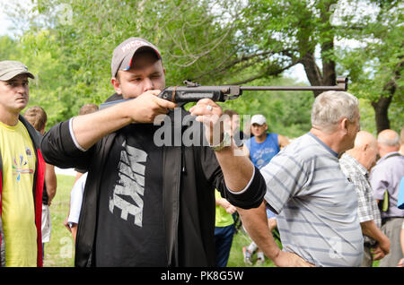 Komsomolsk-on-Amur, Russia - August 8, 2016. Public open Railroader's day. man shoot from pneumatic guns in competition - Stock Photo