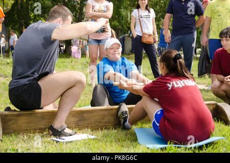 Komsomolsk-on-Amur, Russia - August 8, 2016. Public open Railroader's day. judge gives signal to the start of the fight in women's wrestling - Stock Photo