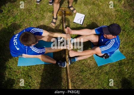 Komsomolsk-on-Amur, Russia - August 8, 2016. Public open Railroader's day. Two men wrestlers ready to fight in amateur competitions. view from above. - Stock Photo