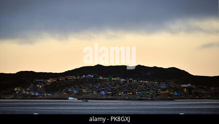 Aasiaat in the evening  twilight. Disco Bay. West Greenland. - Stock Photo