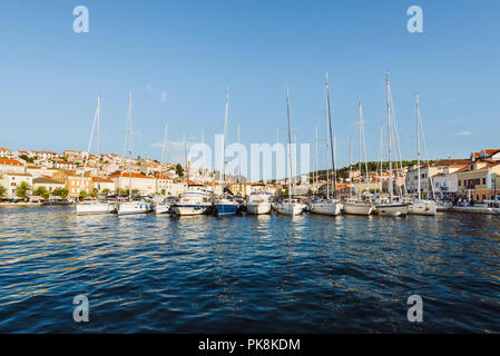 Sailing boats and yachts moored in the harbor of Mali Lošinj in the warm evening light, island Lošinj, Kvarner bay, Croatia - Stock Photo