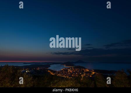 The port and city of Mali Lošinj on the island of Lošinj with the Osoršćica mountain range after sunset, Lošinj, Kvarner bay, Croatia - Stock Photo