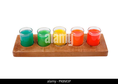 Multicolored opaque cocktails, a set of shots in one row, five servings on a wooden stand, substrate. Side view Isolated white background. Drink for t - Stock Photo