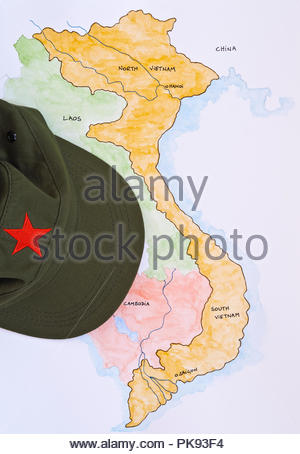 Green peak hat with Red Star, on painted map of Vietnam, Indo-China - Stock Photo