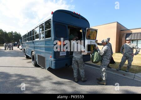 U.S. Airmen from the South Carolina Air National Guard and 169th Fighter Wing, prepare to deploy from McEntire Joint National Guard Base to Bluffton, South Carolina, to support partnered civilian agencies and safeguard the citizens of the state in advance of Hurricane Florence, September 10, 2018, September 10, 2018. Approximately 800 South Carolina National Guard Soldiers and Airmen have been mobilized to prepare, respond and participate in recovery efforts as forecasters project Hurricane Florence will increase in strength with potential to be a Category 4 storm and a projected path to make  - Stock Photo