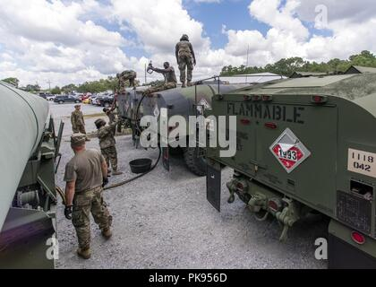 South Carolina National Guard Soldiers from the 118th Forward Support Company transfer bulk diesel fuel into M987 HEMTT fuel tanker trucks for distribution in preparation to support partnered civilian agencies and safeguard the citizens of the state in advance of Hurricane Florence, September 10, 2018, September 10, 2018. Approximately 1600 Soldiers and Airmen have been mobilized to prepare, respond and participate in recovery efforts as forecasters project Hurricane Florence will increase in strength with potential to be a Category 4 storm and a projected path to make landfall near the Caroli - Stock Photo