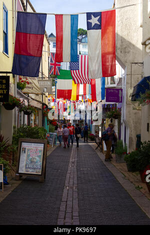 Foss Street in Dartmouth with flags flying for the annual regatta - Stock Photo