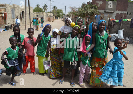 Sustainable Development Goals: kids on their way to school, Joal-Fadiouth (Senegal) - Stock Photo